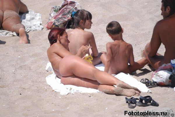naturists and nudists naked topless on the beach (570)